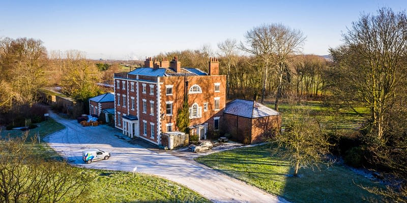 drone shot of the traffors hall building